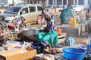 A woman sells produce in the Juba Market in old town.