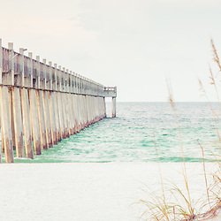 Pensacola Beach Florida Gulf Pier and beach grass panorama photo. Pensacola Beach is a coastal city along the Emerald Coast in the Southeastern United States. Panoramic photo ratio is 1:3. Copyright ⓒ 2018 Paul Velgos with All Rights Reserved.