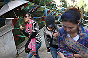 Tourists ascend the stairs at Dukezong Temple in Shangri-la, Yunnan, China; September, 2013.