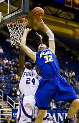 December 28, 2009; Berkeley, CA, USA;  UC Santa Barbara Gauchos forward Jon Pastorek (32) is fouled by Furman Paladins forward Brandon Sebirumbi (24) during the second half at the Haas Pavilion.  UC Santa Barbara defeated Furman 72-60.
