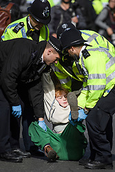 © Licensed to London News Pictures. 10/10/2019. London, UK. Police arrest an Extinction Rebellion activist for refusing to move from the roads around Trafalgar Square in Westminster, central London where they have been demonstrating for a fourth day running. The climate change group have blockaded the Westminster area, demanding that the government takes immediate and decisive action on climate change. Photo credit: Ben Cawthra/LNP