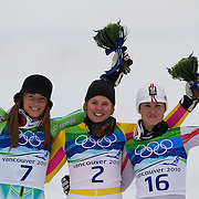 Winter Olympics, Vancouver, 2010.Medal winners, Tina Maze, Slovenia, Silver, Left, Viktoria Rebensburg, Germany, Gold, Centre and Elisabeth Goergl, Austria, Bronze, right, in the Alpine Skiing Ladies' Giant Slalom at Whistler Creekside, Whistler, during the Vancouver Winter Olympics. 24th February 2010. Photo Tim Clayton