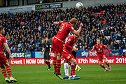 Captain Dean Lewington of MK Dons clears the ball during the EFL Sky Bet League 1 match between Bolton Wanderers and Milton Keynes Dons at the University of  Bolton Stadium, Bolton, England on 16 November 2019.
