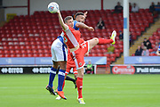 Oldham Athletic striker Aaron Amadi-Holloway (10) beats Walsall midfielder Shaun Donnellan (23) to a header 0-0 during the EFL Sky Bet League 1 match between Walsall and Oldham Athletic at the Banks's Stadium, Walsall, England on 12 August 2017. Photo by Alan Franklin.