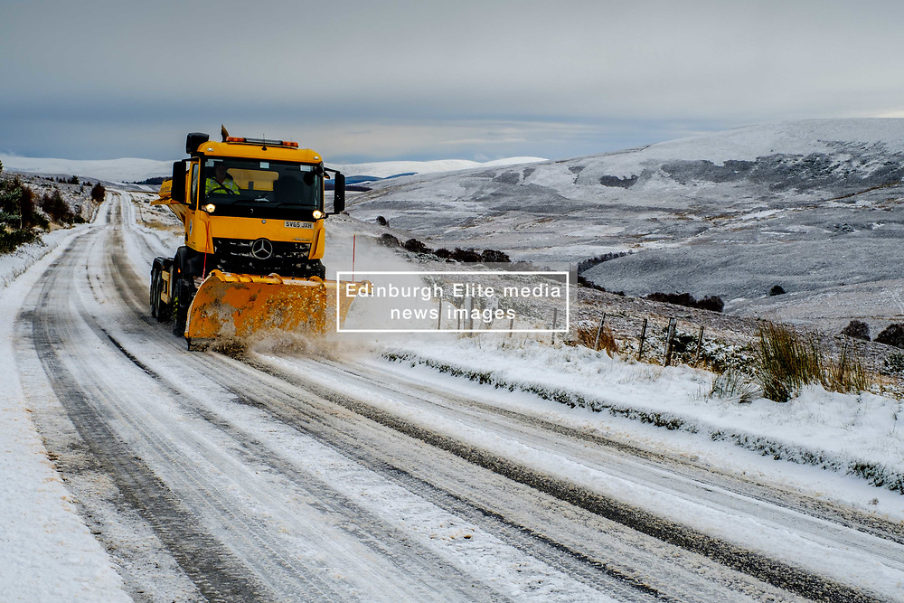 Winter comes to the Scottish Highlands - A snow plow clears the A939 Old Military Road near Tomintoul.  At 1400 feet above sea level it is one of the highest roads in Scotland.<br /> <br /> (c) Andrew Wilson   Edinburgh Elite media
