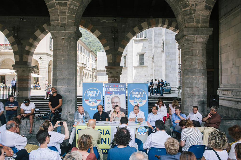 COMO, ITALY - 21 JUNE 2017: Residents of Como attend Mario Landriscina's rally,  the leading candidate for mayor of Como after the first round of voting to replace the left-leaning mayor, here at the Broletto, a medieval building next to the Cathedral in Como, Italy, on June 21st 2017. Mr Landriscina wants to close the reception centers.<br /> <br /> Residents of Como are worried that funds redirected to migrants deprived the town&rsquo;s handicapped of services and complained that any protest prompted accusations of racism.<br /> <br /> Throughout Italy, run-off mayoral elections on Sunday will be considered bellwethers for upcoming national elections and immigration has again emerged as a burning issue.<br /> <br /> Italy has registered more than 70,000 migrants this year, 27 percent more than it did by this time in 2016, when a record 181,000 migrants arrived. Waves of migrants continue to make the perilous, and often fatal, crossing to southern Italy from Africa, South Asia and the Middle East, seeing Italy as the gateway to Europe.<br /> <br /> While migrants spoke of their appreciation of Italy&rsquo;s humanitarian efforts to save them from the Mediterranean Sea, they also expressed exhaustion with the country&rsquo;s intricate web of permits and papers and European rules that required them to stay in the country that first documented them.