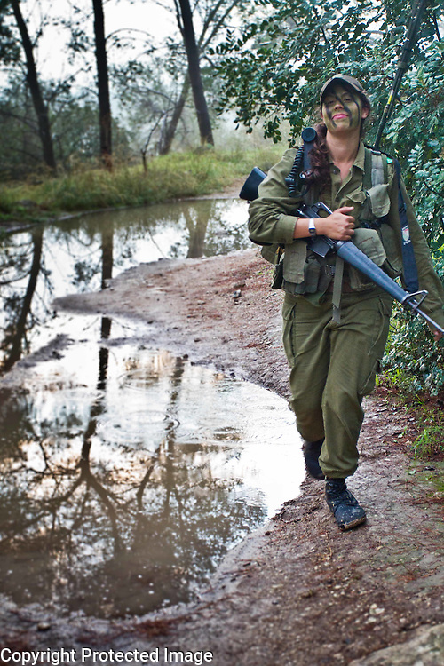 Israeli women serving in the Ma'agal army unit on a pre dawn march in central Israel. Photography by Debbie Zimelman, Modiin, Israel. Debbie specializes in documentary style photography