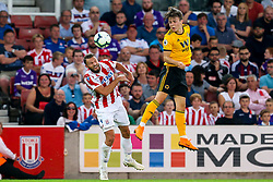 Oskar Buur of Wolverhampton Wanderers wins a header - Mandatory by-line: Robbie Stephenson/JMP - 25/07/2018 - FOOTBALL - Bet365 Stadium - Stoke-on-Trent, England - Stoke City v Wolverhampton Wanderers - Pre-season friendly