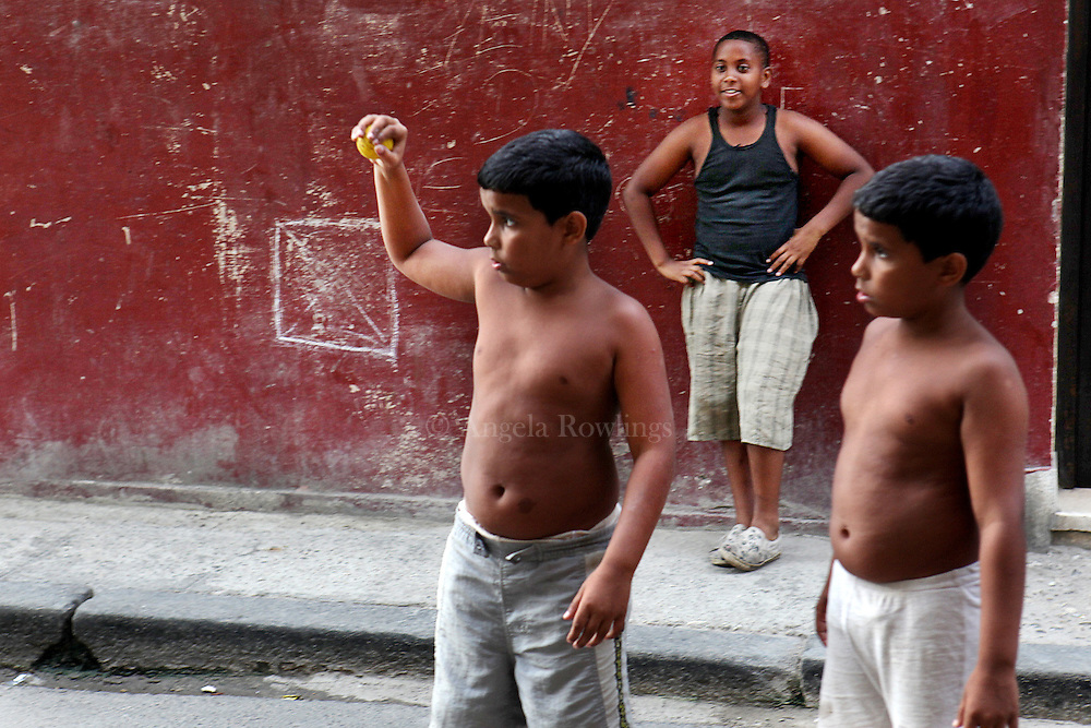 Twin boys play in the street with a friend in Havana, Cuba, Wednesday,  April 28, 2010.