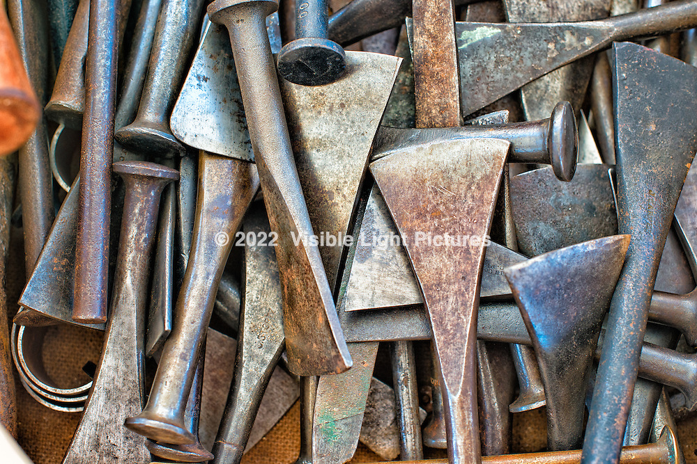 Old metal wood carving chisels at the Wooden Boat Show in Mystic Seaport, Mystic, CT