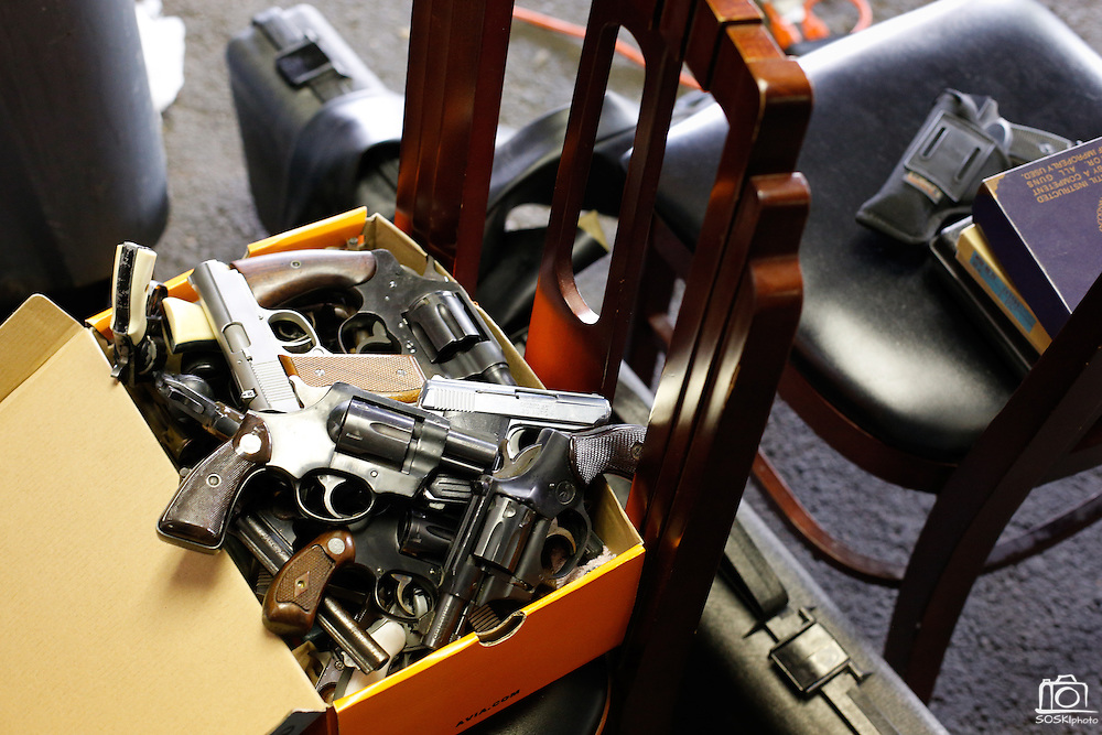 A box full of handguns sit in the back of The Stewpot's parking garage as members and volunteers of the First Presbyterian Church of Dallas buy unwanted guns from owners in Dallas, Texas, on January 19, 2013.  The church is paying $50 for handguns, shotguns, rifles, and up to $200 for semi-automatic assault rifles.  The guns are later destroyed.  (Stan Olszewski/The Dallas Morning News)