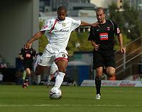 Photo: Ian Hebden.<br />Milton Keynes Dons v Hartlepool United. Coca Cola League 2. 09/09/2006.<br />MK Dons Clive Platt (L) shoots before Hartlepools Ben Clark (R) can intercept.