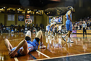 Dakota Wesleyan's Collin Kramer (12) lays on the floor as the clock expires and the Tigers fall to College of Idaho 62-60 during a game in the second round of the NAIA Division II National Tournament on Friday at the Sanford Pentagon in Sioux Falls. (Matt Gade / Republic)