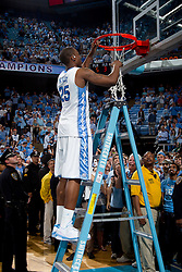 CHAPEL HILL, NC - MARCH 05: Justin Knox #25 of the North Carolina Tar Heels cuts down the net after defeating the Duke Blue Devils and winning the regular season ACC championship on March 05, 2011 at the Dean E. Smith Center in Chapel Hill, North Carolina. North Carolina won 67-81. (Photo by Peyton Williams/UNC/Getty Images) *** Local Caption *** Justin Knox