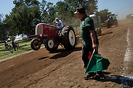 A tractor driver finishes a run during a tractor pull in Girard, Kansas, Sep. 6, 2010.