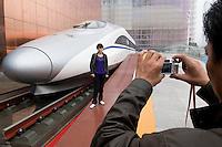 A Chinese fast train is displayed at Shanghai Expo 2010. <br /> <br /> Les chinois decouvrent les nouveautes de la technologie chinoise, ici le train a grande vitesse.
