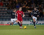 8th December 2017, Dens Park, Dundee, Scotland; Scottish Premier League football, Dundee versus Aberdeen; Dundee's Scott Allan goes past Aberdeen's Greg Stewart as Jon Aurtenetxe watches