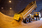 After being chipped the wood is stored in a local airfield bunker, there are about 50 tonnes stored ready for use in wood chip boilers. Suffolk county council sustainable wood chip production, Suffolk.