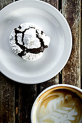 Powered Cookie on a White Plate with Coffee to the side