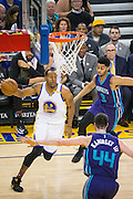 Golden State Warriors forward Andre Iguodala (9) drives to the basket against the Charlotte Hornets at Oracle Arena in Oakland, Calif., on February 1, 2017. (Stan Olszewski/Special to S.F. Examiner)