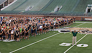 President Roderick McDavis stands on the 50-yard line and poses with first-year students for the Class of 2020 photo on the field of Peden Stadium on Saturday, August 20, 2016. ©Ohio University / Photo by Kaitlin Owens