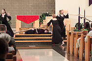 Jubilee members interpret Station Nine, where Jesus falls the third time, during a performance of 'The Way of the Cross' at St. Luke Catholic Parish in Beavercreek, Friday, March 30, 2012.  'The Way of the Cross' retraces 'the path Jesus walked on his way to Calvary.'