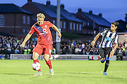 George Swann & Ayoze Perez during the Pre-Season Friendly match between York City and Newcastle United at Bootham Crescent, York, England on 29 July 2015. Photo by Simon Davies.