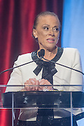 Lonnie Ali, vice chair and co-founder of the Muhammad Ali Center, presents Philanthropist and businesswoman Cindy Hensley McCain with the prestigious Muhammad Ali Humanitarian Award for Lifetime Achievement at the fourth annual Muhammad Ali Humanitarian Awards Saturday, Sept. 17, 2016 at the Marriott Hotel in Louisville, Ky. (Photo by Brian Bohannon for the Muhammad Ali Center)