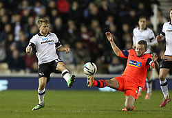 Derby County's Jamie Ward battles with Boltons Jay Spearing - Photo mandatory by-line: Matt Bunn/JMP - Tel: Mobile: 07966 386802 16/02/2014 - SPORT - FOOTBALL - IPro Stadium - Pride Park - Derby - Derby County v Bolton - Sky Bet Championship
