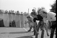 Striking miners at Orgreave playing boules in front of riot police. 18 June 1984