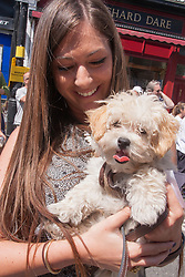 "Primrose Hill, London, May 18th 2014. Katie Shemesh and her ""Malitpoo"" Smootie enjoy the warm sunshine at the Primrose Hill Fair dog show in London"