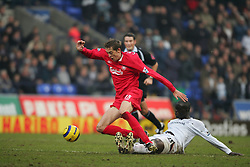 BOLTON, ENGLAND - MONDAY, JANUARY 2nd, 2006: Liverpool's Peter Crouch is tackled by Bolton Wanderers' Abdoulaye Faye during the Premiership match at the Reebok Stadium. (Pic by David Rawcliffe/Propaganda)