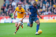 Uche Ikpeazu (#19) of Heart of Midlothian holds off Tom Aldred (#5) of Motherwell FC during the Ladbrokes Scottish Premiership match between Motherwell and Heart of Midlothian at Fir Park, Motherwell, Scotland on 15 September 2018.
