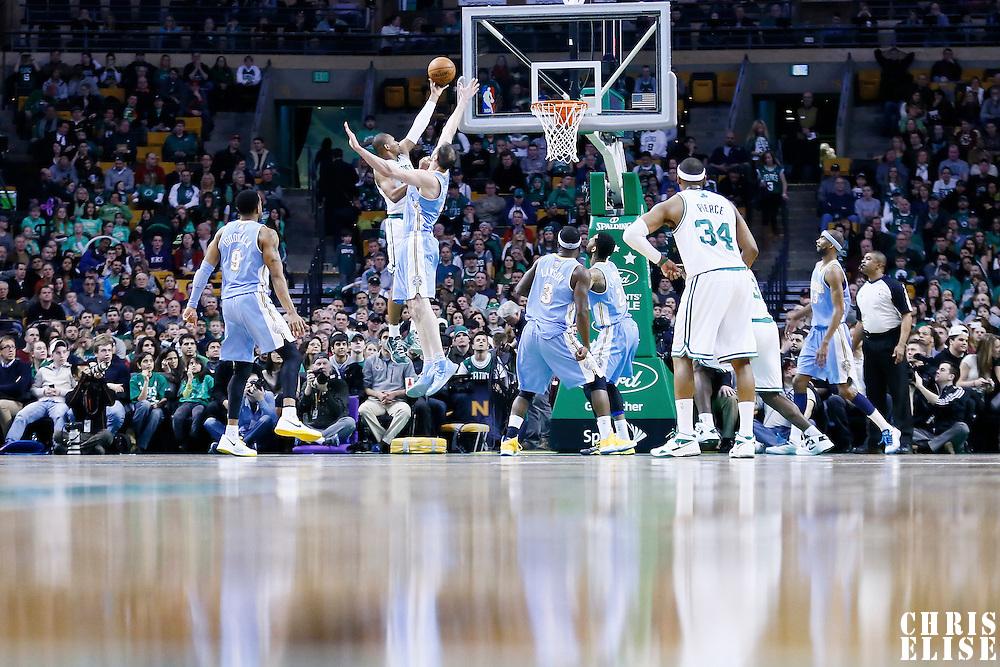 10 February 2013: Boston Celtics shooting guard Leandro Barbosa (12) goes for the layup over Denver Nuggets center Kosta Koufos (41) during the Boston Celtics 118-114 3OT victory over the Denver Nuggets at the TD Garden, Boston, Massachusetts, USA.