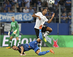 SINHEIM, Aug. 16, 2017  Joel Matip (R) of Liverpool and Sandro Wagner of 1899 Hoffenheim compete during the UEFA Champions League Qualifying Play-Offs Round First Leg match at Wirsol Rhein-Neckar-Arena in Sinsheim, Germany, on August 15, 2017. Liverpool won 2-1. (Credit Image: © Joachim Bywaletz/Xinhua via ZUMA Wire)