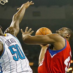 January 3, 2011; New Orleans, LA, USA; Philadelphia 76ers power forward Elton Brand (42) shoots over New Orleans Hornets center Emeka Okafor (50)during the first quarter at the New Orleans Arena.   Mandatory Credit: Derick E. Hingle