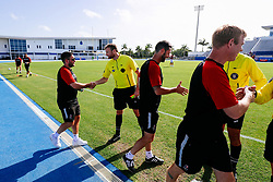Bristol City manager Lee Johnson greets the officials during the 2nd leg of the match after the previous day's game was abandoned at half time due to extreme weather - Rogan/JMP - 14/07/2019 - IMG Academy, Bradenton - Florida, USA - Bristol City v Derby County - Pre-Season Tour Day 3.