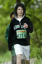 """(Kingston, Ontario---16/05/09) """"Thomas Kostociannis running in the kids race at the 2009 Salomon 5 Peaks Trail Running series Race held in Kingston, Ontario as part of the Eastern Ontario/Quebec division. """"  Copyright photograph Sean Burges / Mundo Sport Images, 2009. www.mundosportimages.com / www.msievents.com."""