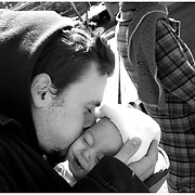 Gabe Albanese kisses his infant daughter Jubilee as he walks his girlfriend Jenn Horne, right,  to Cape Fear Tattoos in Greenville N.C.