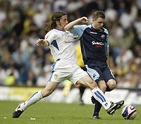 Photo: Aidan Ellis.<br /> Leeds United v Swansea City. Coca Cola League 1. 22/09/2007.<br /> Leeds  David Prutton challenges Swansea's Paul Anderson