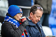 Reading fan drinks a hot drink during the EFL Sky Bet Championship match between Reading and Birmingham City at the Madejski Stadium, Reading, England on 7 December 2019.
