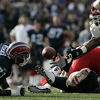 ansas City Chiefs defensive end #92 recovers a fumble after Buffalo Bills quarterback Kelly Holcomb was sacked during the first quarter at Ralph Wilson Stadium. The Buffalo Bills beat the Kansas City Chiefs 14-3.