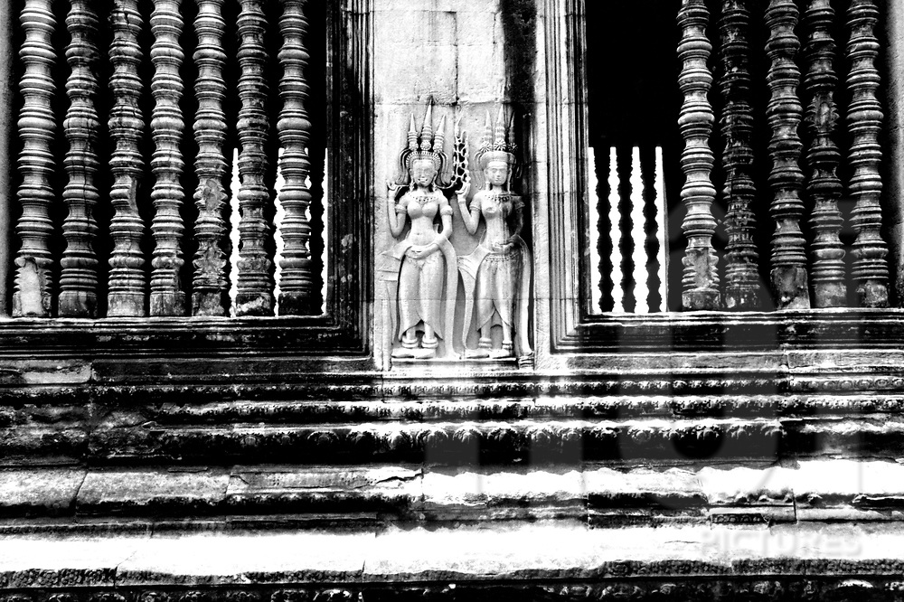 Relief on wall with two goddess dancers Angkor Wat, Cambodia, Asia.