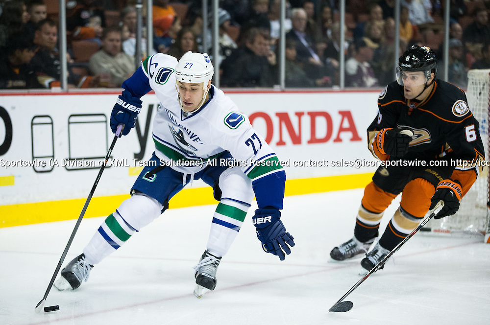 December 28, 2014 - Vancouver Canucks Left Wing Shawn Matthias (27) [5773] controls the puck, while Anaheim Ducks Defenceman Ben Lovejoy (6) [6537] brings pressure during the game between Vancouver Canucks and Anaheim Ducks at Honda Center in Anaheim, CA. Ducks defeated Canucks in overtime 2-1.