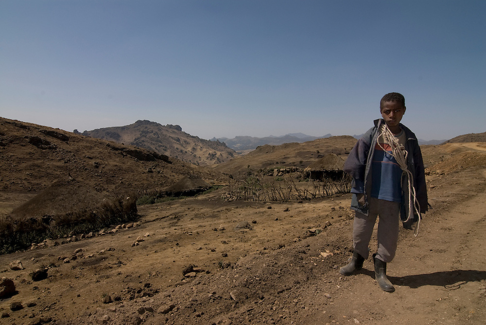 Young boy standing before the Bale mountains, Ethiopia,Africa