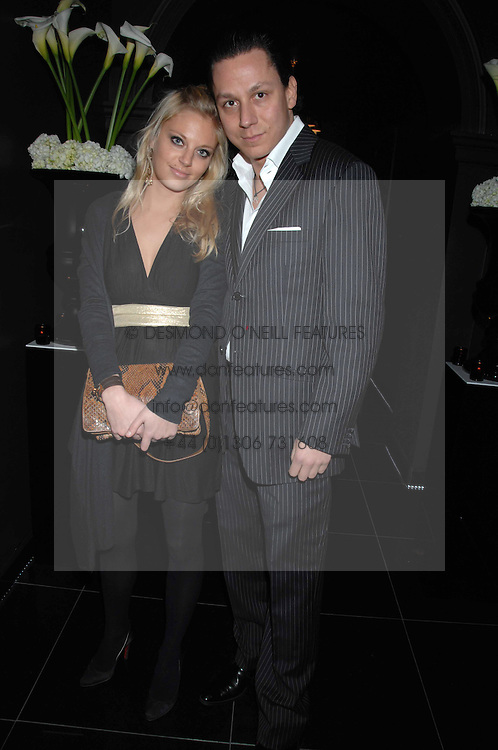 NICK GOLD and LARA HUTTUMEN at the grand opening of the Amika nightclub, 65 High Street Kensington, London on 28th February 2007.<br />