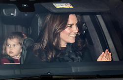 © Licensed to London News Pictures. 20/12/2017. London, UK. The Duchess of Cambridge leaves Buckingham Palace with Charlotte after attending the Queen's annual Christmas lunch. Photo credit: Peter Macdiarmid/LNP