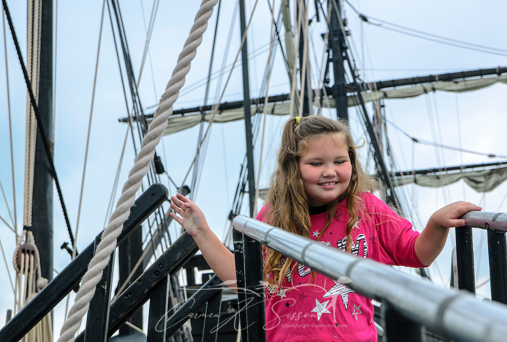 Kerighan Ridings, 7, strikes a pose for her grandmother, Debra Ridings (not pictured) as she prepares to board the  Pinta Thursday afternoon at the Columbus Marina. The ship, a replica of one of the three vessels Italian explorer Christopher Columbus sailed on his 1492 voyage, will be in Columbus through Monday.  (Photo by Carmen K. Sisson/Dispatch Staff)