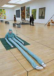 Sitting Man with dots on blue carpet Carpet by Peter Land at Statens Museum for Kunst or Royal Museum of Fine Arts in Copenhagen Denmark