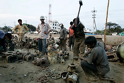 BANGLADESH MADHOM BIBIR HAT 6MARB05 - Labouroers break valves at one of the many secondary businesses selling hardware recovered from shipbreaking yards at Badhom Bibir Hat outside Chittagong, Bangladesh. ..jre/Photo by Jiri Rezac..© Jiri Rezac 2005..Contact: +44 (0) 7050 110 417.Mobile: +44 (0) 7801 337 683.Office: +44 (0) 20 8968 9635..Email: jiri@jirirezac.com.Web: www.jirirezac.com..© All images Jiri Rezac 2005 - All rights reserved.